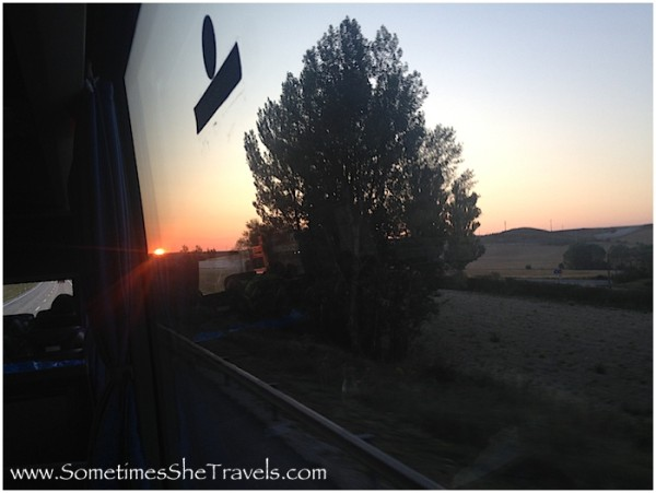 Sunrise through bus window on highway from the night bus to Pamplona