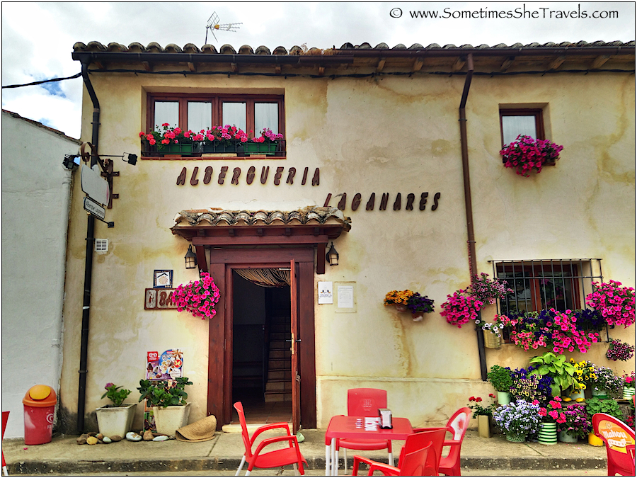 Spanish-style building with flower boxes