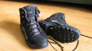 Black and gray hiking boots on wood floor