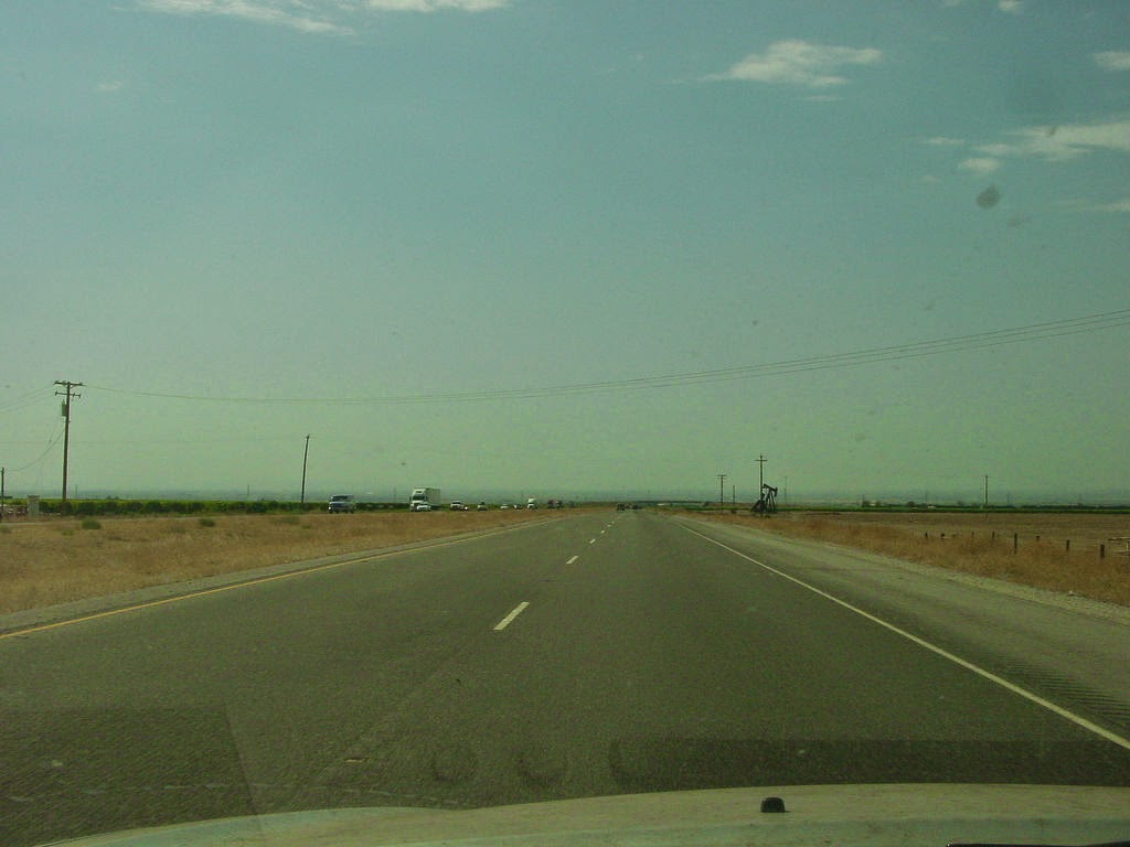 Boring highway on flatland through windshield