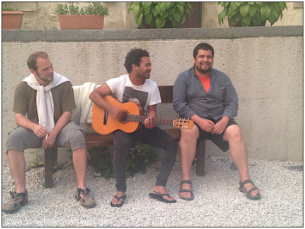 Day 2: Yan(?), Al, and Benjamin providing the pilgrims with music in the courtyard at Roncesvalles.