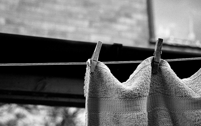 Towel pinned to clothesline with clothespins