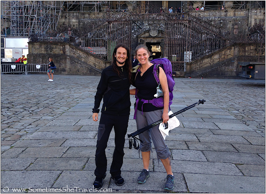 Smiling man and woman in front of cathedral in Spain