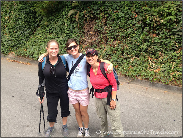 Three women in hiking clothes with arms around each other