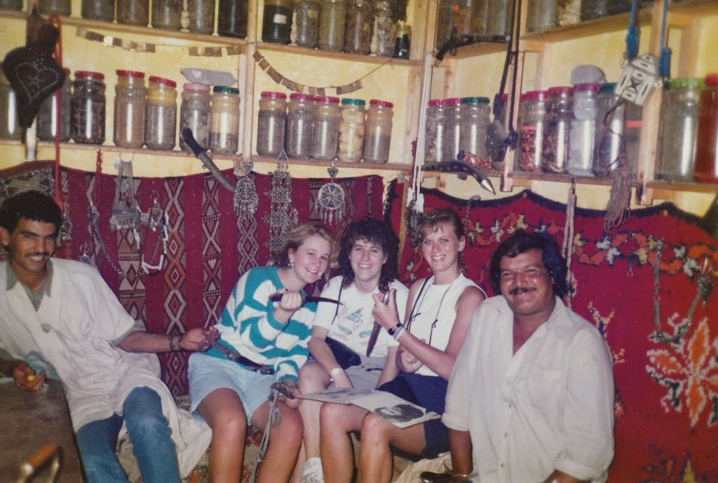 Three girls and man in Moroccan spice shop