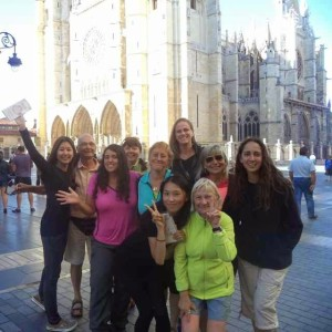 Nine women standing in front of cathedral