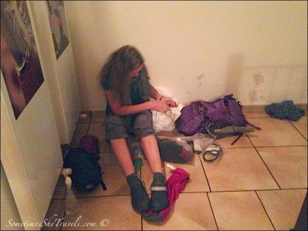Packing in the Hallway of the Albergue
