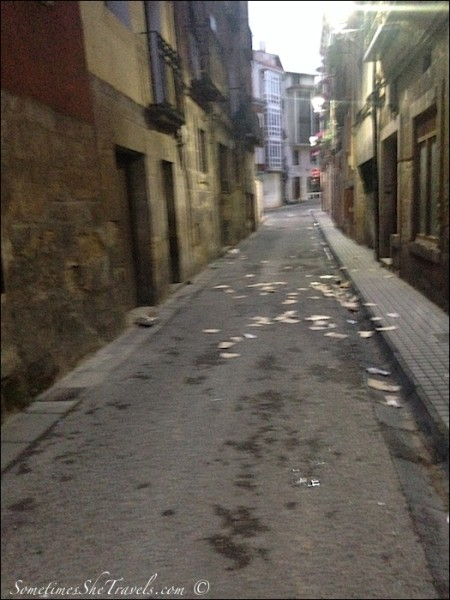 The trash-strewn post-party morning streets of Nájera.