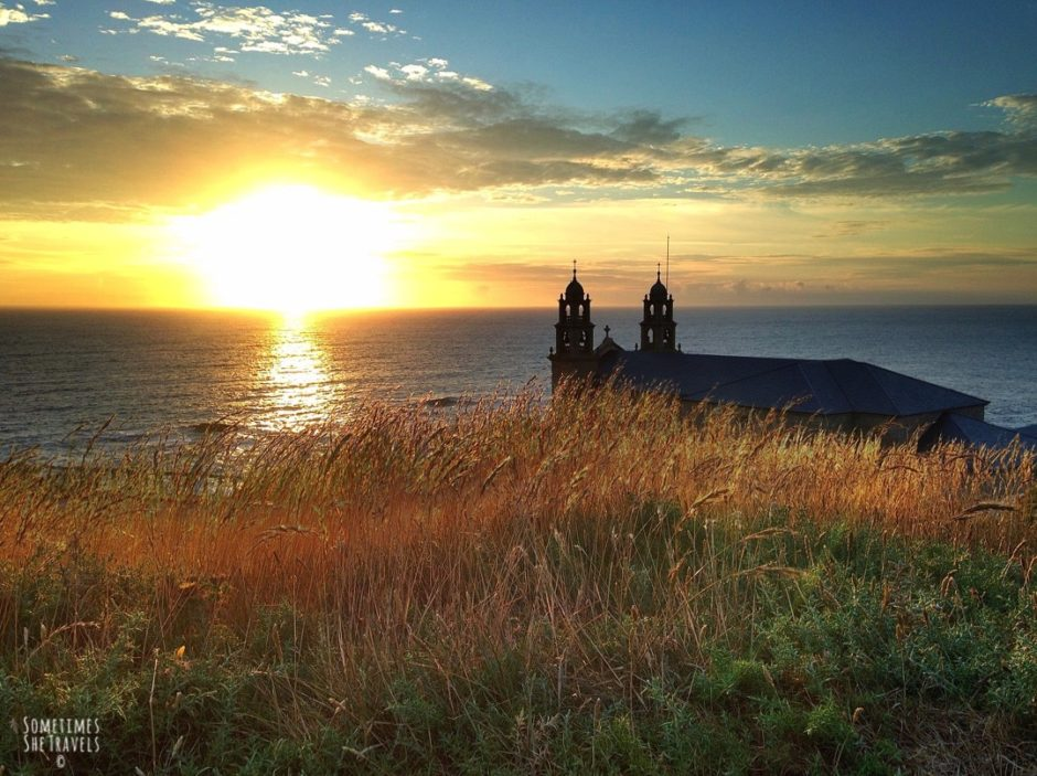church near ocean at sunset